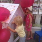 Attendees decorating the Trend & Thomas Wendy House